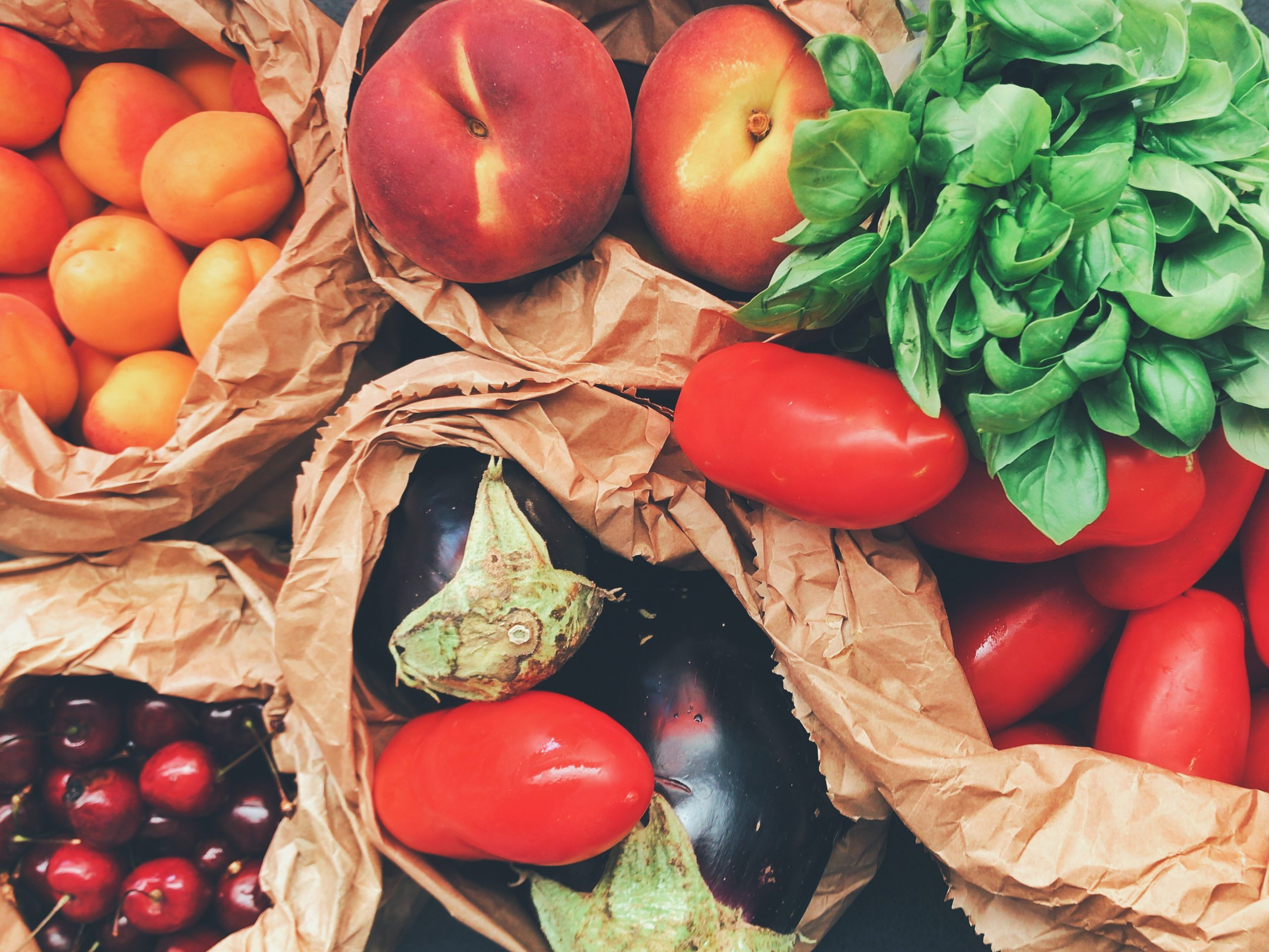 Fruits And Veggies In Brown Paper Bags