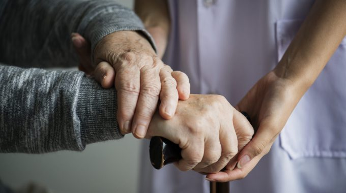 Caregiver Holding Hand Of Loved One