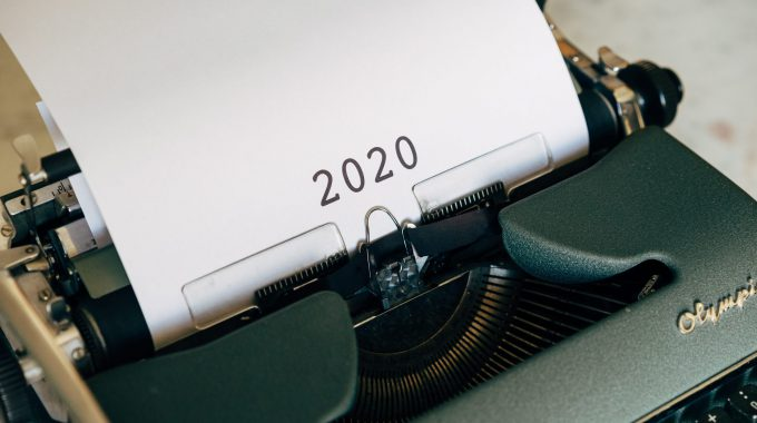 Typewriter With A Piece Of Paper In It That Says 2020
